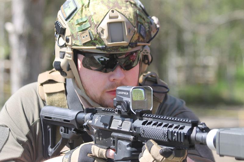 man shooting airsoft gun