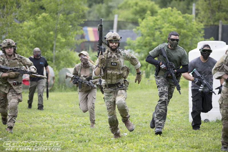 group of people running in their airsoft gear
