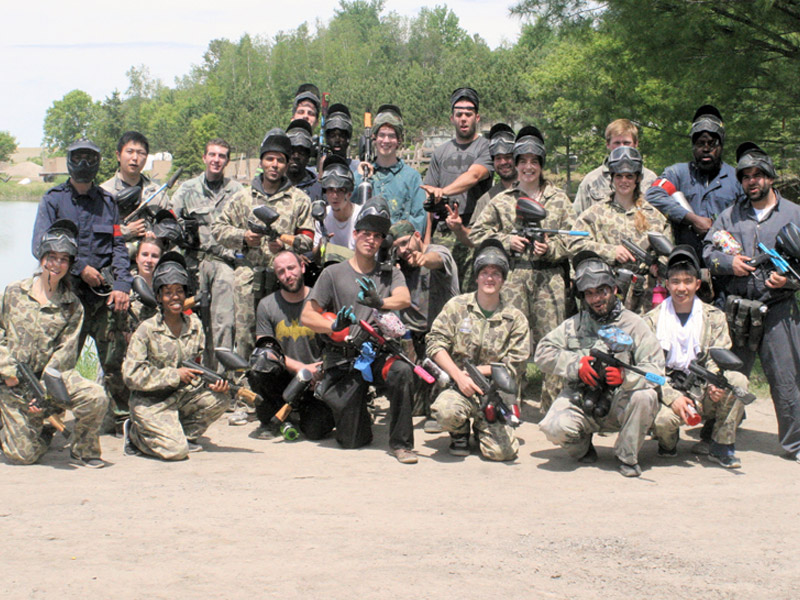 team of people with their paintball equipment