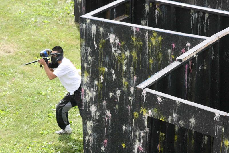 man shooting paintball gun at Commando Paintball